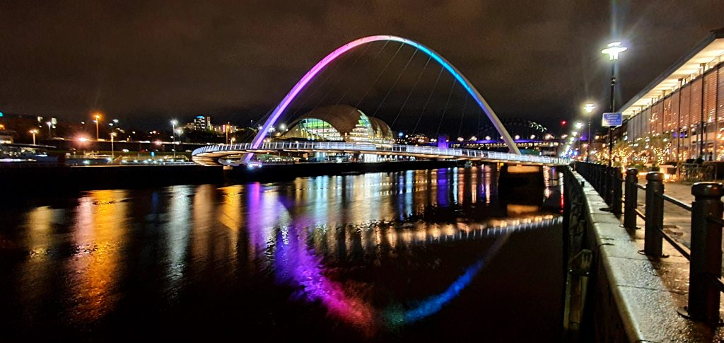 The beautiful reflection of the Bridge in the river at night